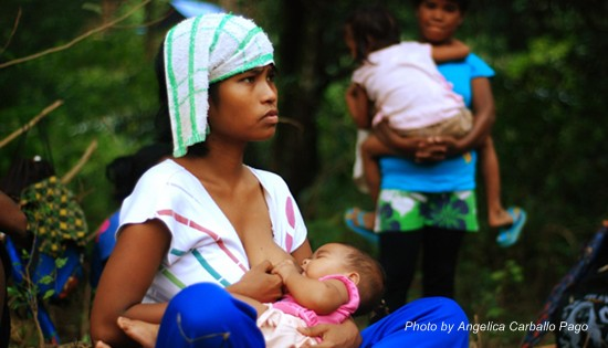 A Dumagat woman breastfeeds her six-month-old baby